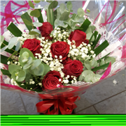 Six red rose,gypsophilia and foliage bag bouquet
