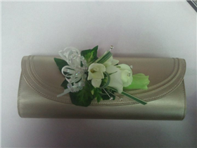 rose, lizzianthus and freesia bag corsage.
