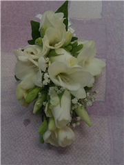 freesia and rose corsage